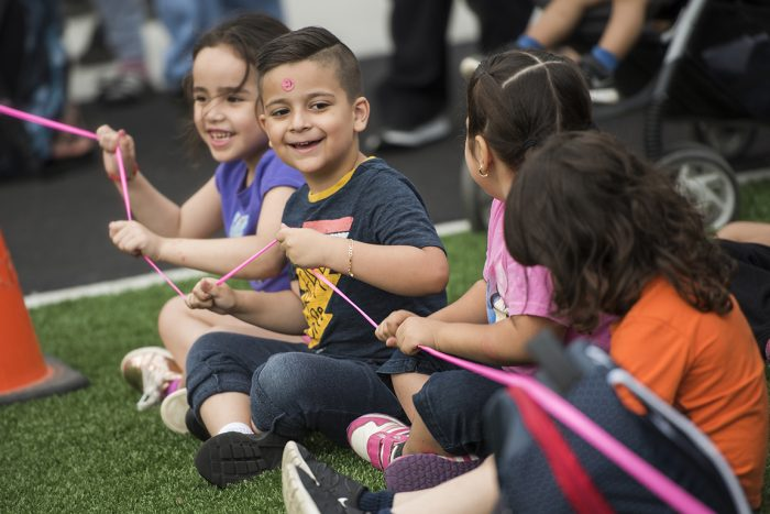 Students play on new schoolyard equipment