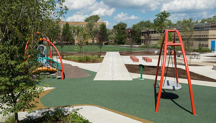 Transformed schoolyard at Cook Elementary, new playground equipment and field